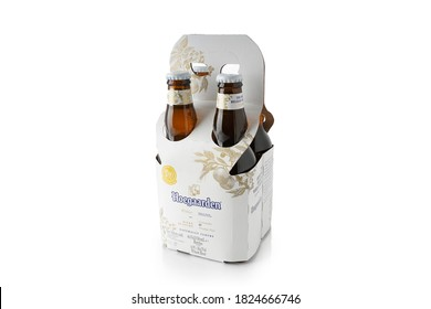 Buenos Aires, Argentina - August 19, 2020. Four Pack of Hoegaarden beer isolated on white background. Alcoholic beverage