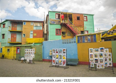 BUENOS AIRES, ARGENTINA - AUGUST 21, 2014: Historical tenement houses and paintings in Caminito street on August 21, 2014 in La Boca, Buenos Aires, Argentina.