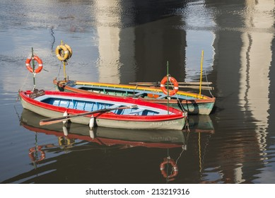 BUENOS AIRES, ARGENTINA - AUGUST 21, 2014: Two taxi boats anchored in the Riachuelo river on August 21, 2014 in the neighborhood of La Boca, Buenos Aires city, Argentina.