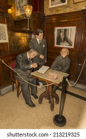 BUENOS AIRES, ARGENTINA - AUGUST 21, 2014: Statues of Alfonsina Storni, Jorge Luis Borges and Carlos Gardel by Gustavo Fernandez at the Cafe Tortoni on August 21, 2014 in Buenos Aires, Argentina.