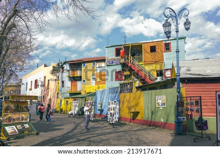 BUENOS AIRES, ARGENTINA - AUGUST 21, 2014: Historical tenement house besides Caminito street on August 21, 2014 in La Boca, Buenos Aires, Argentina. Nowadays functions as a complex of shops and bars.