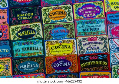 BUENOS AIRES, ARGENTINA - AUGUST 6, 2016: Background of colorful door signs, made in traditional Buenos Aires fileteado painting style, at a weekend fair in San Telmo neighborhood, Buenos Aires