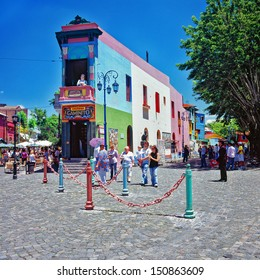 BUENOS AIRES, ARGENTINA - CIRCA DEC 2009: Unidentified tourists walks on the street. La Boca is a popular destination for tourists visiting Argentina, with its colorful houses and pedestrian street.