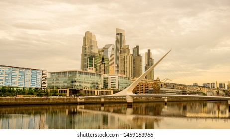 BUENOS AIRES, ARGENTINA - CIRCA FEBRUARY 2019: View on skyscrapers and the famous Bridge of the Woman in the neighborhood of Puerto Madero circa February 2019 in Buenos Aires, Argentina.