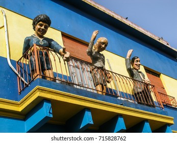 Buenos Aires, Argentina - Circa May 2011: Statues of Diego Maradona, Evita Peron and Carlos Gardel at a balcony on the colorful street of Caminito in La Boca neighborhood