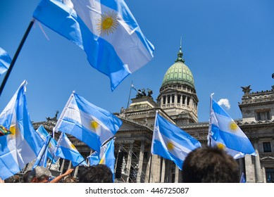 Buenos Aires, Argentina - Dec 10, 2015: Supporters of the newly elected Argentinean president wave flags on inauguration day at the the Congress.