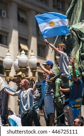 Buenos Aires, Argentina - Dec 10, 2015: Supporters of the newly elected Argentinean president wave flags on inauguration day at the Plaza de Mayo.