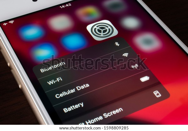 BUENOS AIRES, ARGENTINA - DECEMBER 26, 2019: iPhone's settings icon displays bluetooth and wifi options to access easily