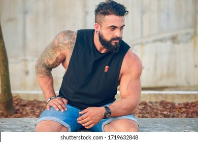 Buenos Aires, Argentina - December 5th 2019: Young bearded muscular male model in urban shoot.