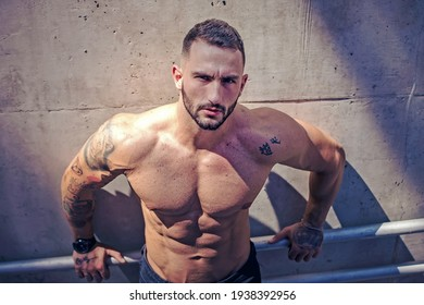 Buenos Aires, Argentina - Decenber 17th, 2019: Young muscular male model in urban shoot.