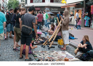 Buenos Aires, Argentina. Feb 2, 2014. A man plays a didgeridoo at one selling spot in San Telmo street market.