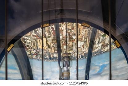 Buenos Aires, Argentina - Feb 9, 2018: Buenos Aires city reflected on the beacon of Palacio Barolo (Barolo Palace) lighthouse - Buenos Aires, Argentina