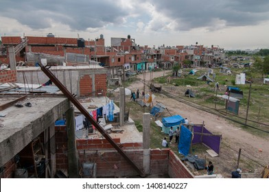 Buenos Aires, Argentina. February 28, 2014.  To the left the slum known as Villa 20; to the right the lands a group of dwellers took over for some months until finally evicted.