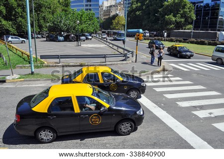 Buenos Aires, Argentina- Jan 20, 2011: City taxi are painted in black and yellow on the street. Buenos Aires is located on western shore of estuary of Río de la Plata.