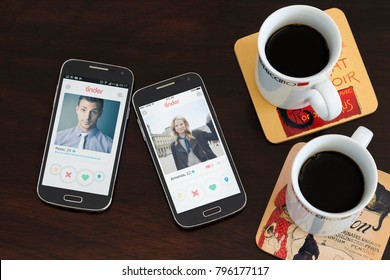 BUENOS AIRES, ARGENTINA - JANUARY 15, 2018: Two cell phones over the table, on the screen of both its open the Tinder application with a profile of a men and a woman respectively. Social network.