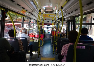 Buenos Aires, Argentina - January, 2020: People riding in a bus. Passengers sitting on seats inside of city public bus.