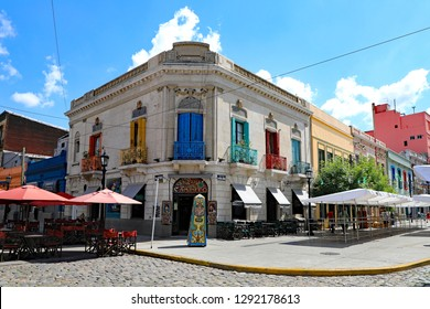 BUENOS AIRES, ARGENTINA - JANUARY 8, 2019:  The La Boca neighborhood with colorful painted buildings in Buenos Aires, Argentina.  Home of the Tango dance.