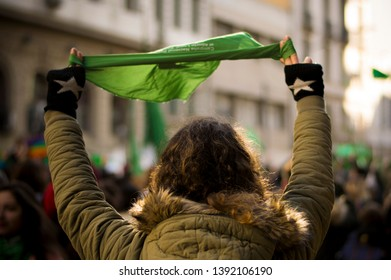 Buenos Aires, Argentina; June, 14, 2018.  Young woman with green scarf. Feminist manifestation in support of the law for legal abortion, safe and free