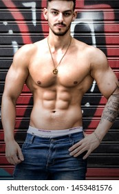 Buenos Aires, Argentina March 12th 2019: Young shirtless male bodybuilder in urban shots.