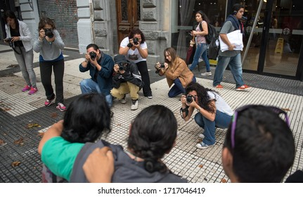 Buenos Aires, Argentina - March 18 2016: Students of Photography showing their passion and enthusiasm taking pictures with DSLR camera in the streets of Buenos Aires