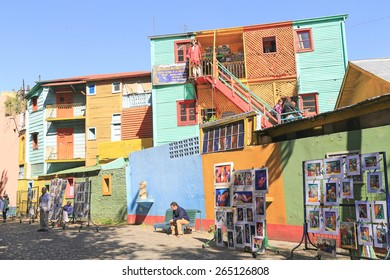 Buenos Aires, Argentina - March, 23 2014 :  Tourists admiring colorful building and street art in the famous district of La Boca in Buenos Aires