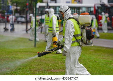 Buenos Aires, Argentina - March 3, 2016: Employees of the Ministry of Environment and Public Space fumigate for Aedes aegypti mosquitos to prevent the spread of Zika virus and dengue fever in park.