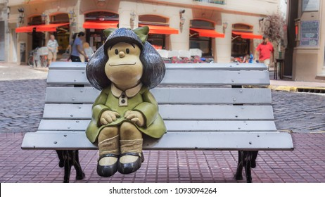 Buenos Aires, Argentina, March 4, 2013 , Mafalda, comic character girl sitting on bench in the street in Buenos Aires