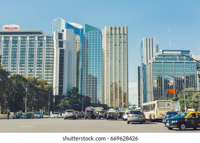 "BUENOS AIRES, ARGENTINA - MAY 09, 2017: Transit in the center of Buenos Aires, on the Libertador avenue, in front of modern buildings of the Alem avenue, zone denominated ""El bajo"""