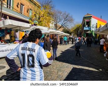 BUENOS AIRES, ARGENTINA - MAY 25, 2018: Man with Maradona jersey in Caminito, La Boca