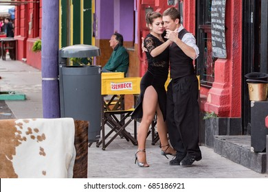 BUENOS AIRES, ARGENTINA - MAY, 9 2015 - Buenos Aires Argentina Tango Dancer on the barrio la boca painted house streets