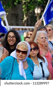 "BUENOS AIRES, ARGENTINA - NOV 17: An unidentified woman marches in Buenos Aires, Argentina with ""The Mothers of the Plaza de Mayo"" on Nov 17, 2011"