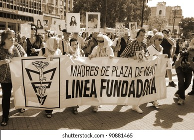 """BUENOS AIRES, ARGENTINA - NOV 17: Unidentified women march in Buenos Aires, Argentina with """"The Mothers of the Plaza de Mayo"""" on Nov 17, 2011."""