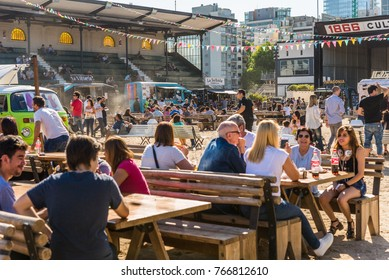 Buenos Aires, Argentina - November 25, 2017: People at a street food market festival on a sunny day