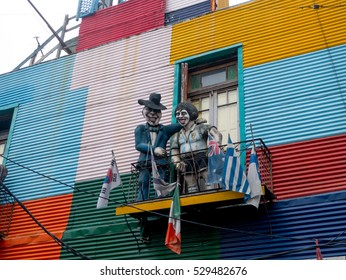 BUENOS AIRES, ARGENTINA - NOVEMBER 29, 2016: Statues of Diego Maradona and singer Carlos Gardel are seen in La Boca neighbourhood in Buenos Aires, Argentina