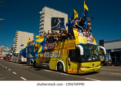 "Buenos Aires, Argentina. October 10, 2007. A bus carrying Boca Juniors football team fans goes to River Plate stadium to play the ""classic of classics"" match between Boca and River."