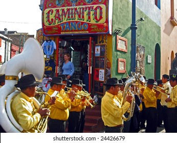 BUENOS AIRES, ARGENTINA - OCTOBER 12: A street band plays in the La Boca district of Buenos Aires, Argentina October 12, 2006. La Boca is a tourist attraction and where the Tango originated.