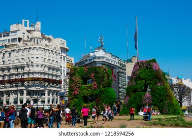 Buenos Aires, Argentina. October 14, 2018. Vertical garden, BA characters at Republic Square (Plaza de la Republica) and Obelisk of Buenos Aires (El Obelisco) in the background