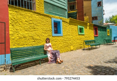 BUENOS AIRES, ARGENTINA - OCTOBER 17,2017 - In the streets of La Boca in Buenos Aires is a number of colorful houses and tango teachers