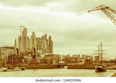 BUENOS AIRES, ARGENTINA - SEPT 20: Rio de la Plata, with the bridge of the woman, in the port district of Puerto Madero, now converted into a tourist and office area. Vintage and yesteryear effect