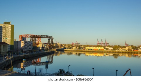 BUENOS AIRES, ARGENTINA - SEPTEMBER 13:  Panorama of the industrial part of La Boca, with cranes of the port and the bridge of Avellaneda in the background. Buenos Aires, Argentina