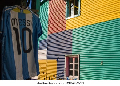 BUENOS AIRES, ARGENTINA - SEPTEMBER 13: The Argentine shirt of Lionel Messi exposed next to the colorful buildings of the neighborhood of La Boca in Buenos Aires, Argentina.