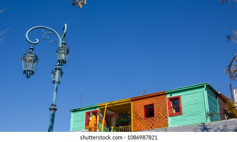 BUENOS AIRES, ARGENTINA - SEPTEMBER 13:  Streetlight with the colorful houses in Caminito, a traditional alley, of great cultural and tourism, in the district of La Boca in Buenos Aires, Argentina.