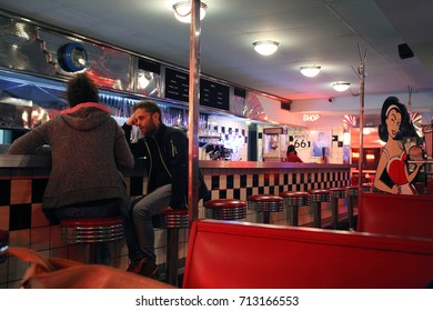 BUENOS AIRES, ARGENTINA - SEPTEMBER 2017 - Unidentified couplen on a restaurant called Trixie in Buenos Aires with an old american diner ambiance