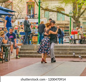 BUENOS AIRES, ARGENTINA, SEPTEMBER - 2018 - Tango dancers couple making an show at traditional dorrego square at san telmo district in buenos aires city, Argentina