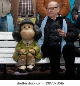 Buenos Aires, Argentina. September 29, 2014. Joaquin Lavado, better known as Quino, caresses a scultpure of his most famous character, Mafalda, by artist Pablo Irrgang.