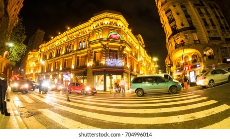 BUENOS AIRES, ARGENTINA - SEPTEMBER 7: View of the traffic at night in front of the Galerias Pacifico on September 7, 2016 in Buenos Aires, Argentina.