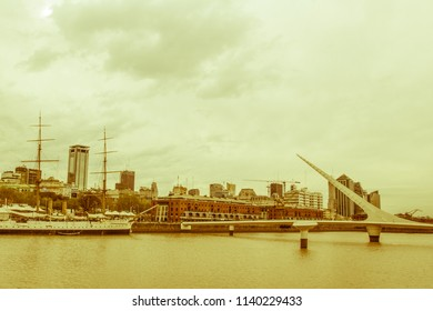 BUENOS AIRES, ARGENTINA-SEPTEMBER 20: View of Puerto Madero, with the frigate Sarmiento and the woman bridge. Puerto Madero, now converted into a tourist and office area. Vintage and yesteryear effect