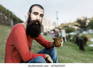 Buenos Aires, Argentine - January 2018: bearded man drinking mate in Science Park