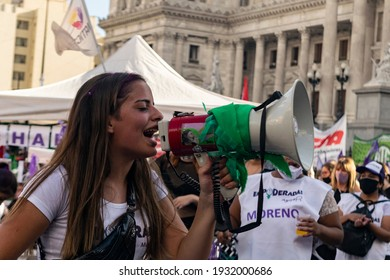 Buenos Aires city, Argentina - March 8, 2021: Women marching, protesting and holding posters in March for Women's Day in the city of Buenos Aires Argentina.