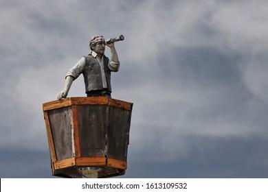BUENOS AIRES - DECEMBER 03, 2019: Statue of a sailor standing inside a lookout over the Kraken bar.